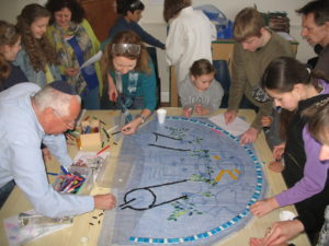 Beiteinu pupils working on the Shalom Mosaic that welcomes all to KLS